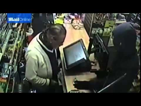 FULL Shopkeeper Sees Off ARMED Burglar by Throwing Bag Back at Him
