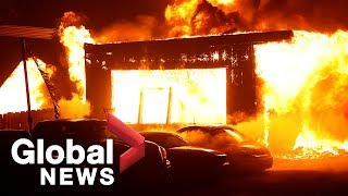 Fast-moving California blazes cause thousands to flee