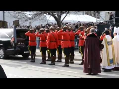 Jim Flaherty's coffin taken away from funeral