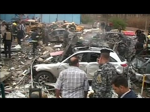 Dozens killed in Iraq minibus suicide bombing