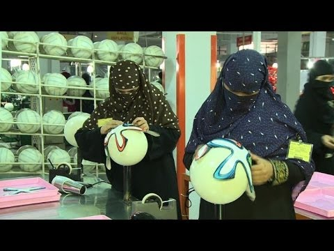 Pakistan workers fire 'Brazuca' ball to Brazil World Cup