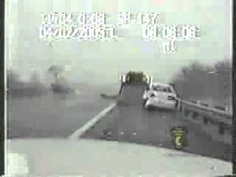Police Officer Dashcam footage: tow- truck driver getting struck by a car. Two The Rescue