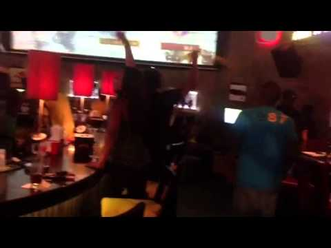 Usain Bolts sports bar in Jamaica, reaction of the patrons