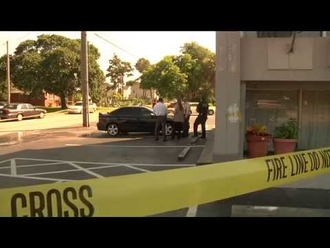 Police investigating body found in car with gunshot wound