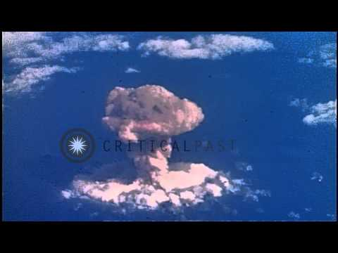 Nuclear bomb blast explosion seen high in sky at Nevada test site in Nye County, ...HD Stock Footage