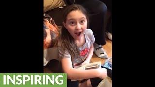 Little girl learns she'll be a big sister