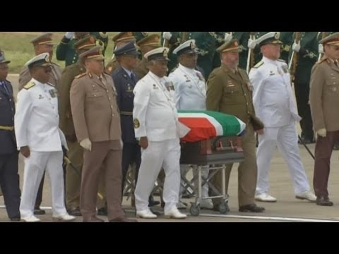 Nelson Mandela's body arrives in childhood village Qunu ahead of his funeral