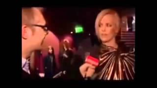 Charlize Theron speaking Afrikaans with Dutch speaking Belgian reporter