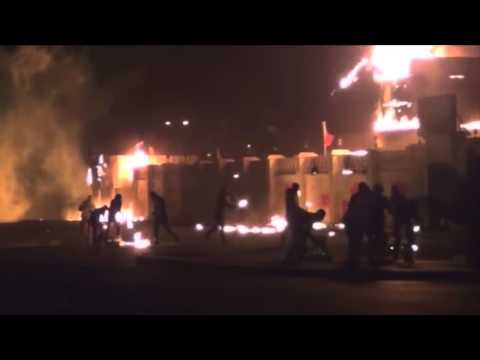 Burning a police station after killing a protester (Bahrain)