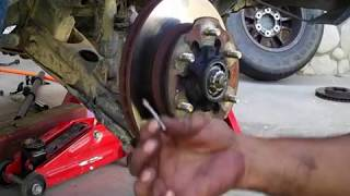 How To Remove Rotors From Nissan Frontier 2003.wmv