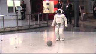 AP - Raw: Obama Plays Soccer With Japanese Robot