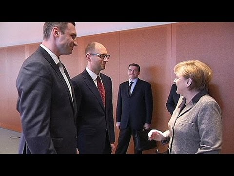 Ukraine opposition leaders meet Merkel in Germany