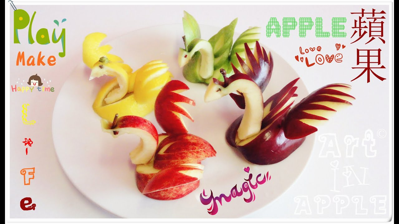 Art in apples show fruit carving apple swan
