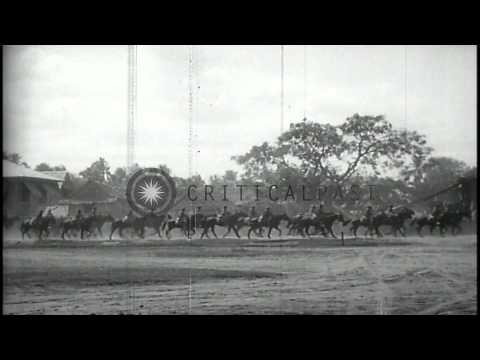 45th infantry marches and rides horses on street in Dagupan, Pangasinan, Philippi...HD Stock Footage
