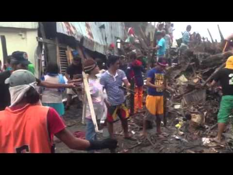 People clearing the streets in Tacloban