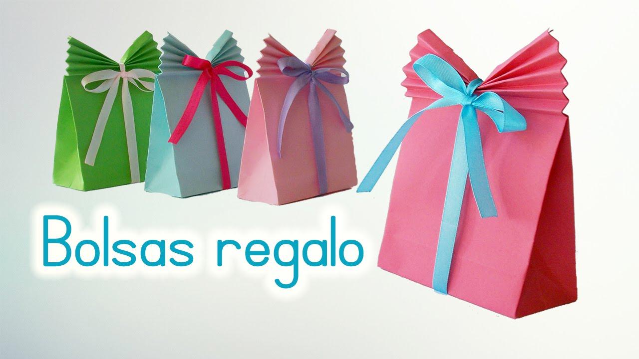 Manualidades bolsas de papel para regalo innova - Papel partitura para manualidades ...