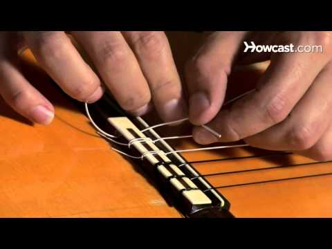 How to Play Guitar: Beginners / Restringing a Nylon-String Acoustic Guitar