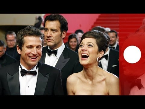 Guillaume Canet, Marion Cotillard and Clive Owen in the red carpet