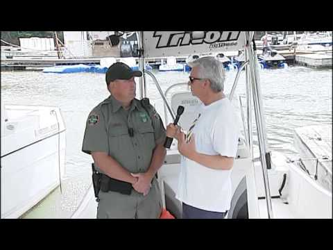 Morgan talks boating safety with a Wildlife Officer.