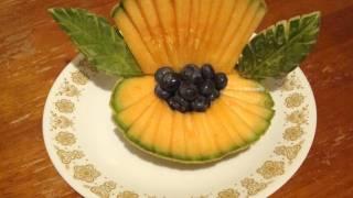 Concha de mar con un melon, decoraciones con fruta