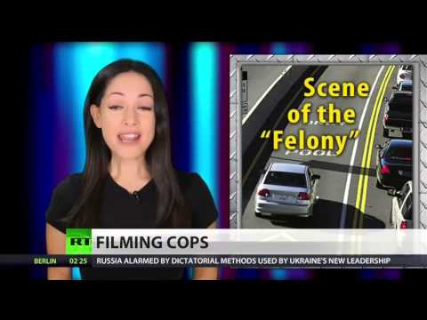 Cop tells woman it s a felony to film him, jails her