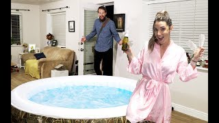 WIFE SURPRISES HUSBAND WITH HOT TUB IN LIVING ROOM!