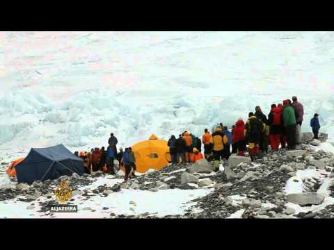 Sherpa guides stage Everest base camp walkout
