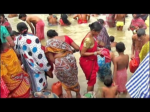 Sweet girls gentle bathing at Ganges/ uncle auntie women are Praying to God after snan