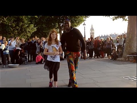 Tourist girl is challenged by street performers in central London