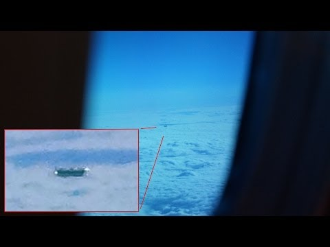 UFO Flies By Plane Window In London UK, May 25, 2014 In The Morning