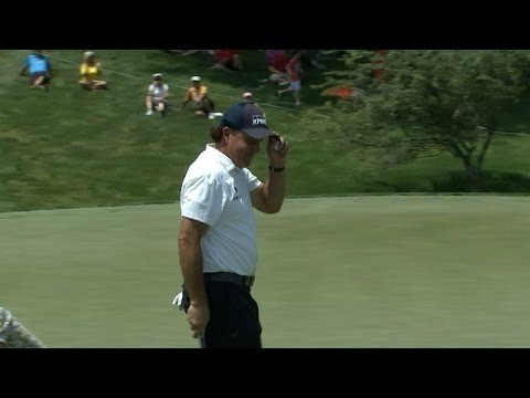 Phil Mickelson's 21-foot birdie putt excites the crowd at