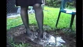 Miss Traci Wet And Muddy In Black Stockings And Black High