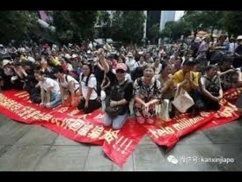 習當局人造經濟數據,慘遭揭穿!中國人習慣下跪,居然跪到外國,齊唱國歌