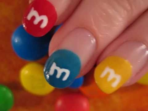 M&M Nail Art, ADD ME TO FACEBOOK: http://www.facebook.com/pages/cutepolish/341207211843 M&M nail art design! candy on your nails ;)