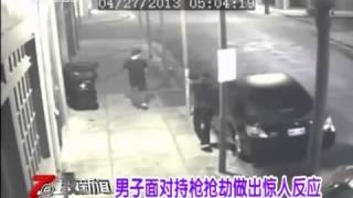 The guy steals the gun from the robber