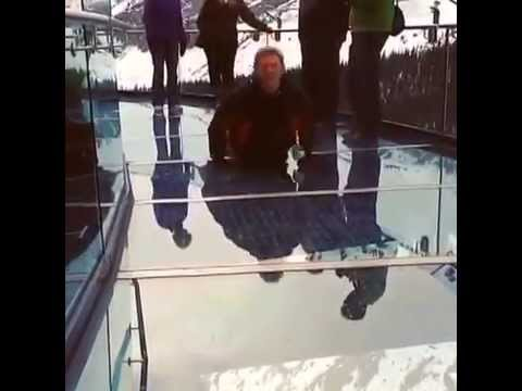 Canadian tourism executive does the worm on glass 900 feet up!