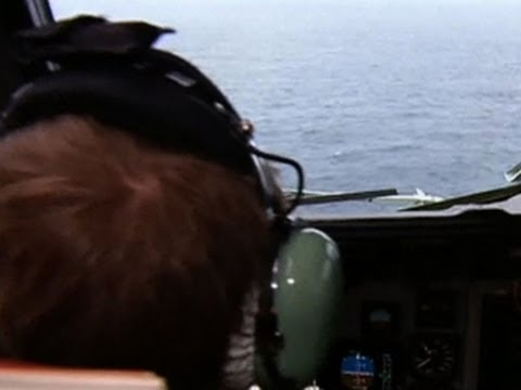 New debris found as search area for Malaysian jet shifts