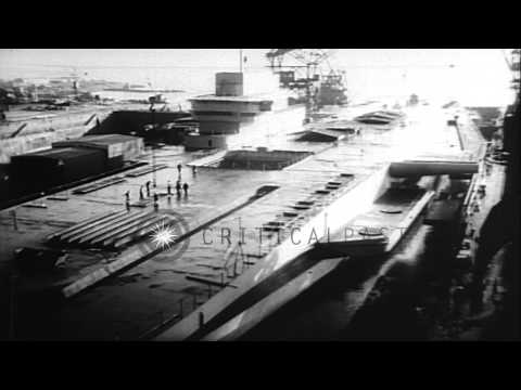 French Navy aircraft carrier Clemenceau (R 98) near completion at a dock before i...HD Stock Footage