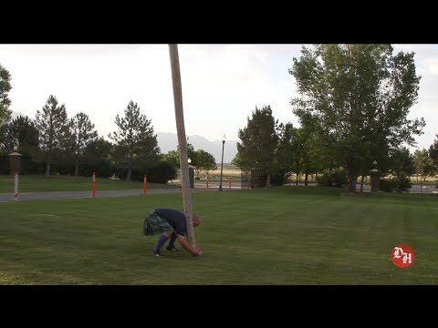 Athlete hurls tree trunk (caber toss) at Scottish Festival