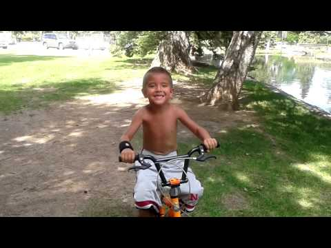 Yamni riding his bike without training wheels