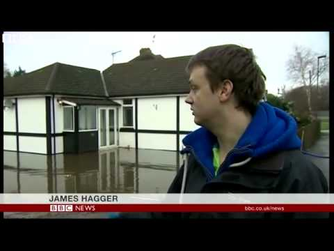 Swollen River Thames floods homes