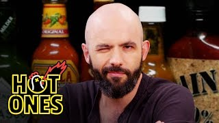Binging with Babish Gets a Tattoo While Eating Spicy Wings | Hot Ones