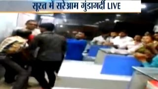 CCTV: Goons beat security guard at a complex in Surat