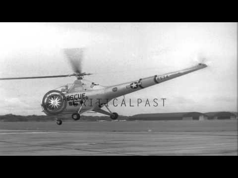 A United States Air Rescue Sikorsky H-5 helicopter lifts off and lands back at Al...HD Stock Footage