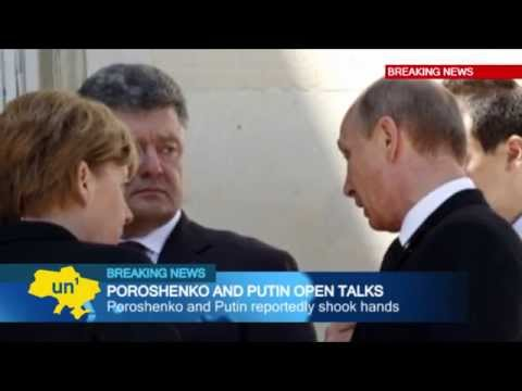 Putin meets Poroshenko: Leaders of Russia and Ukraine talk in France