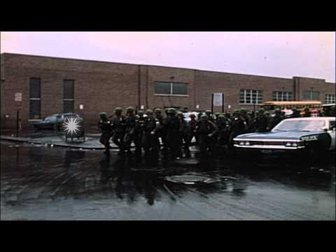 Troops in formation walk through streets after the Baltimore Riots in Baltimore, ...HD Stock Footage