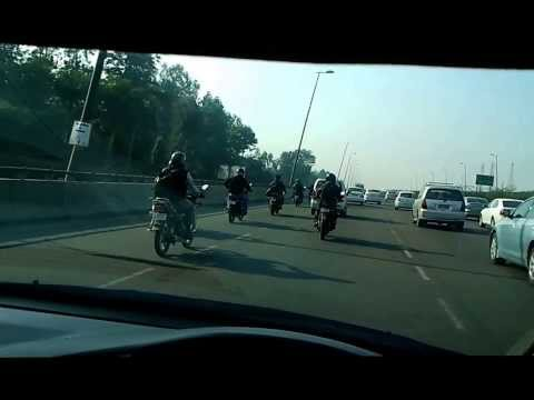 Delhi Driving Two wheelers consuming two out of four lanes Delhi Gurgaon Highway
