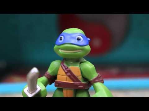 Ninja Rùa chiến đấu với khủng long rừng xanh