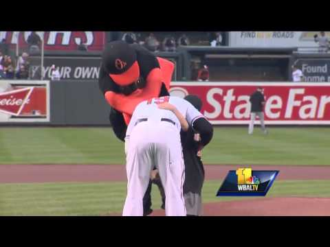 Son of fallen officer throws out first pitch at Orioles game