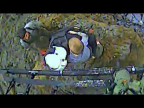 Raw video: Rescue team pulls boy from mudslide